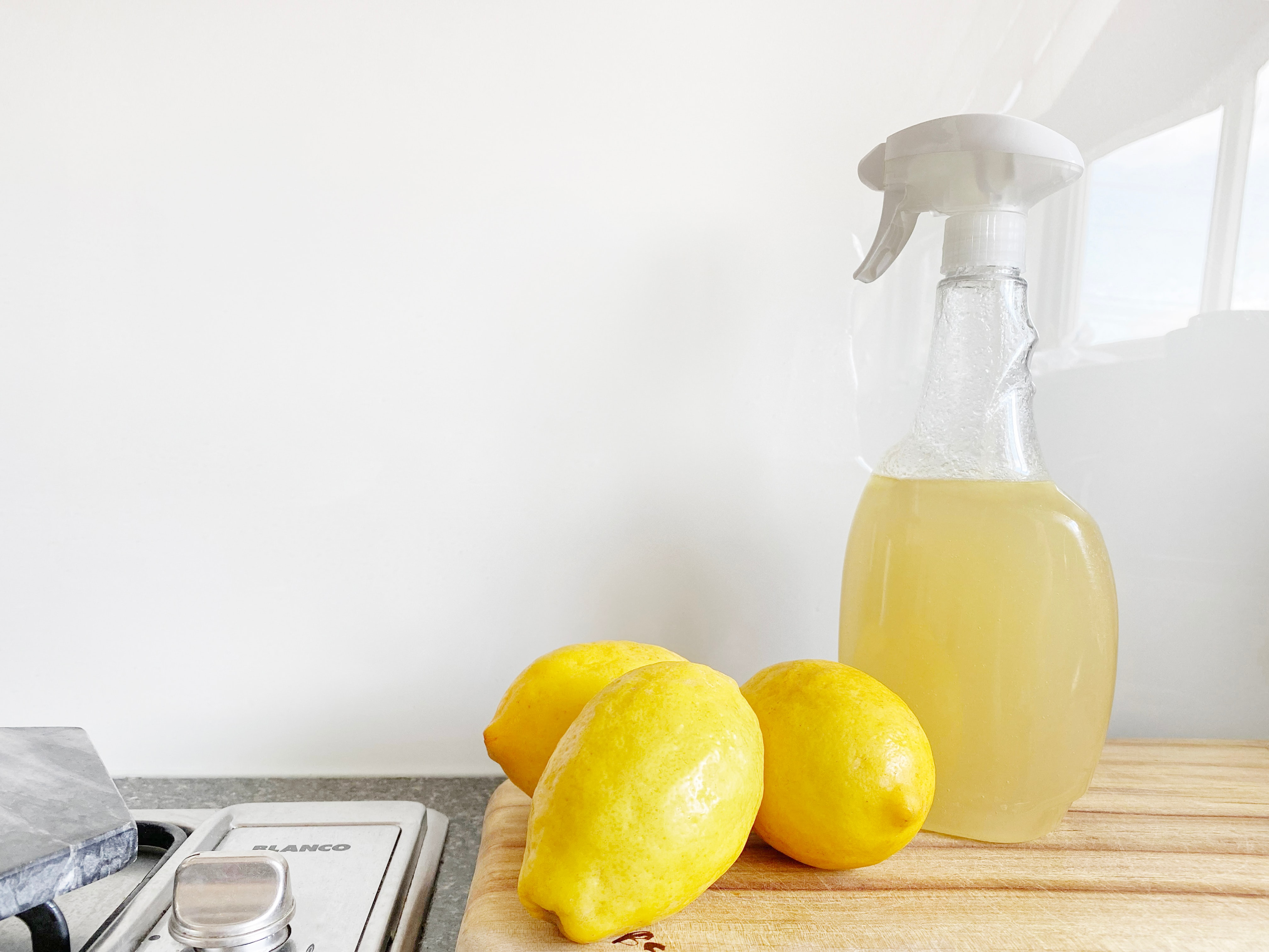 Lemons and cleaning spray bottle
